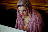 A nervious bride at a traditional arranged Wedding and Walima ceremony. Suleymanie Mosque. Dalston, East London. - Jess Hurd - 01-08-2004