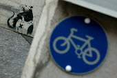 Concrete security barriers adorned with Banksy graffiti. City of London. - Jess Hurd - 01-08-2004