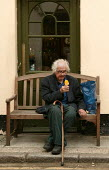 Elderly man eating an ice lolly, Brighton - Jess Hurd - 2000s,2004,adult,adults,age,aged,ageing population,break,confectionery,eating,elderly,enjoy,ENJOYING,enjoyment,food,ice,LEISURE,lolly,male,man,MATURE,men,OAP,OAPS,old,PENSION,pensioner,pensioners,pens