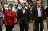 George Galloway MP, Oliur Rahman and Lindsey German walk down Brick Lane at the election launch of Respect the Unity Coalition. East London. - Jess Hurd - 16-05-2004