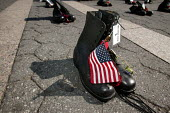 The boots of Spec. Darius T. Jennings 22 SC who was killed whilst serving in in Iraq. Vigil for the Fallen, on the day George Bush is due to be nominated at the Republican National Convention. Organis... - Jess Hurd - 02-09-2004