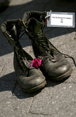 The boots of Pvt Ernest H. Sutphin aged 21 from West Virginia who was killed whilst serving in in Iraq. Vigil for the Fallen on the day George Bush is due to be nominated at the Republican National Co... - Jess Hurd - 02-09-2004