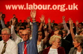 Delegates vote for a motion supporting rail nationalisation. Labour Party Conference. Brighton. - Jess Hurd - 2000s,2004,delegate,Delegates,democracy,NATIONALISATION,Party,people,pol politics,RAIL,RAILWAY,railways,Re Nationalise,renationalise,UK,vote,votes,voting