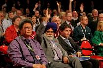 Delegates voting. Labour Party Conference. Brighton. - Jess Hurd - 2000s,2004,BAME,BAMEs,Black,BME,bmes,DELEGATE,Delegates,diversity,ethnic,ethnicity,minorities,minority,NATIONALISATION,nationalise,Party,people,poc,pol politics,renationalise,transport,transportation,