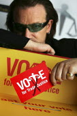 Bono, lead singer of rock band U2. votes for Trade Justice. - Jess Hurd - 29-09-2004