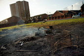 Remains of a smouldering urban fire on a housing estate in the City of Salford. - Jess Hurd - 2000s,2004,against,Anti,anti social behavior,anti social behaviour,anti socialanti social behavior,antisocial,antisocial behaviour,antisocial behaviour order,arson,ASBO,asbos,ASBO's,behavior,behaviour