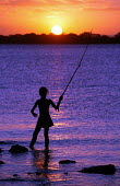 Young Brazilian girl fishes as the sun sets on the World Social Forum, Porto Alegre Brazil. - Jess Hurd - 2000s,2005,americas,Brazilian,Brazilians,child,CHILDHOOD,children,EBF Economy,ENI environmental issues,female,females,fisheries,fisherman,fishermen,fishery,fishes,fishing,girl,girls,juvenile,juveniles