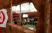 World Social Forum, Porto Alegre Brazil. Delegates in meet in a traditionally built mud hut at the youth camp. - Jess Hurd - 25-01-2005