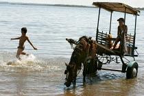 Brazilian children play in the sea at the World Social Forum, Porto Alegre Brazil. - Jess Hurd - 28-01-2005