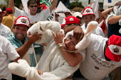World Social Forum, Porto Alegre, Brazil. Small farmers, members of the Brazilian Dairy Union demonstrate outside a closed Parmalat milk factory. Rabbit represents a character from Parmalate advertisi... - Jess Hurd - 28-01-2005