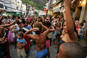 Carnival in Rocinha Favela, Rio De Janeiro where approx 50,000 people live in slum housing, Brazil. - Jess Hurd - 2000s,2005,ace art culture,americas,bad,Brazilian,Brazilians,celebrate,CELEBRATING,celebration,CELEBRATIONS,dance,DANCER,DANCERS,DANCING,EQUALITY,excluded,exclusion,HARDSHIP,housing,impoverished,impov