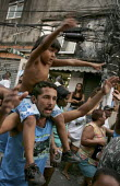 Carnival parade in the favela of Rocinha, Rio De Janeiro, Brazil. - Jess Hurd - 2000s,2005,ACE,americas,Arts,bad,boy,boys,Brazilian,Brazilians,carnival,Carnivals,celebrate,CELEBRATING,celebration,CELEBRATIONS,child,CHILDHOOD,children,Culture,DAD,DADDIES,DADDY,DADS,dance,DANCER,DA