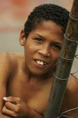 Young lad plays in Magdalena Favela, Sao Paulo where families live in slum housing, Brazil. - Jess Hurd - 03-02-2005