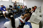 Acao Comunitaria a community based NGO, working with young people in gaining professional qualifications as preparation for work. Magdalena Favela, Sao Paulo where families live in slum housing, Brazi... - Jess Hurd - 03-02-2005