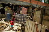 Favela in Cotia on the outskirts of Sao Paulo where families live in slum housing, Brazil. - Jess Hurd - 08-02-2005