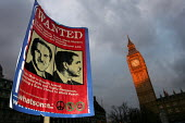 """Wanted poster at a Stop the War demonstration calling for an end to the occupation of Iraq. Mass """"Die-In"""" in Parliament Square,Supported by CND, MAB and the National Union of Students. London. - Jess Hurd - 2000s,2005,activist,activists,anti war,Antiwar,Big Ben,Bush,CAMPAIGN,Campaign for nuclear disarmament,campaigner,campaigners,CAMPAIGNING,CAMPAIGNS,CND,Coalition,DEMONSTRATING,demonstration,DEMONSTRATI"""