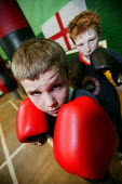 Daniel Hamilton (Front) and Michael Leach train at the St Georges Boxing Club. Poplar Boys and Girls Club. Tower Hamlets, East London. - Jess Hurd - 2000s,2005,adolescence,adolescent,adolescents,amateur,box,boxer,boxers,boxes,boxing,boy,boys,child,CHILDHOOD,children,cities,city,club,clubs,east end,exercise,exercises,exercising,fight,fighter,fighte