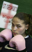 Young women boxers train at the St George Boxing Club. Poplar Boys and Girls Club. Tower Hamlets, East London. - Jess Hurd - 2000s,2005,adolescence,adolescent,adolescents,amateur,box,boxer,boxers,boxes,boxing,child,CHILDHOOD,children,cities,city,club,clubs,east end,EXERCISE,exercises,exercising,female,females,fight,fighter,