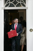 The Chancellor Gordon Brown MP leaves number 11 Downing Street to deliver his budget speech. London - Jess Hurd - 2000s,2005,box,boxes,deliver,finance,FINANCIAL,Labour Party,leaves,London,pol politics,red,Street