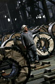 Workers with steel rolls for the export market. Egyptian Iron and Steel Company. Helwan, Cairo, Egypt. - Jess Hurd - 2000s,2005,african,Africans,arab,arabic,arabs,capitalism,capitalist,EBF Economy,egypt,egyptian,FACTORIES,factory,Industries,industry,job,jobs,LAB lbr Work,maker,makers,making,manufacture,manufacturer,
