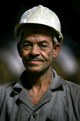 Portrait of a worker at the Egyptian Iron and Steel Company. Helwan, Cairo, Egypt. - Jess Hurd - 2000s,2005,african,Africans,arab,arabic,arabs,capitalism,capitalist,EBF Economy,egypt,egyptian,FACTORIES,factory,hard hat,hats,Industries,industry,job,jobs,LAB lbr Work,maker,makers,making,manufacture