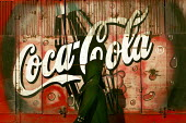 Muslim woman walks past an advert for Coca Cola, Cairo Egypt. - Jess Hurd - 2000s,2005,advert,ADVERTISED,advertisement,advertisements,advertising,ADVERTISMENT,adverts,african,Africans,American,americans,arab,arabic,arabs,CAPITALISM,capitalist,Coca Cola,coke,Cola,company,consu