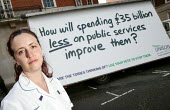 Unison unveils a pastiche of the Conservative party's 'Are you thinking what we're thinking?' posters. London. How will spending �35 billion less on public services improve them? - Jess Hurd - 2000s,2005,activist,activists,ambulance,AMBULANCES,campaign,campaigner,campaigners,campaigning,CAMPAIGNS,DEMOCRACY,DEMONSTRATING,demonstration,DEMONSTRATIONS,election,ELECTIONS,FEMALE,General,health,i