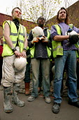 Construction workers walk of site at IPC media to observe one minute silence for International Workers Memorial Day. London. - Jess Hurd - 2000s,2005,activist,activists,CAMPAIGN,campaigner,campaigners,CAMPAIGNING,CAMPAIGNS,Construction Industry,corporate,death,deaths,DEMONSTRATING,demonstration,DEMONSTRATIONS,died,GMB,in,male,man,manslau