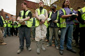 Construction workers walk of site at IPC media to observe one minute silence for International Workers Memorial Day. London. - Jess Hurd - 2000s,2005,activist,activists,CAMPAIGN,campaigner,campaigners,CAMPAIGNING,CAMPAIGNS,Construction Industry,corporate,DEMONSTRATING,demonstration,DEMONSTRATIONS,GMB,in,male,man,manslaughter,media,member
