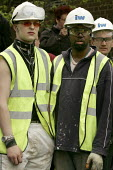Construction workers walk of site at IPC media to observe one minute silence for International Workers Memorial Day. London. - Jess Hurd - 2000s,2005,accident,accidental,accidents,activist,activists,and,BME Black minority ethnic,CAMPAIGN,campaigner,campaigners,CAMPAIGNING,CAMPAIGNS,Construction Industry,corporate,DEMONSTRATING,demonstrat