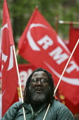 RMT transport union demonstration arrives in London in a campaign against the privatisation of our railways. London - Jess Hurd - 2000s,2005,activist,activists,against,black,BME Black minority ethnic,campaign,campaigner,campaigners,campaigning,CAMPAIGNS,DEMONSTRATING,demonstration,DEMONSTRATIONS,London,member,member members,memb