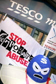 ActionAid Corporate Muscle outside Tesco Metro in Liverpool Street, London, on the eve of Tesco announcing record profits expected to exceed 2 billion pounds, ActionAid releases new research exposing... - Jess Hurd - 11-04-2005