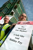 UCATT building workers protest about imposed freelance contracts with no holiday entitlement outside a Community Housing Association site in Plaistow, Newham, East London. - Jess Hurd - 18-05-2005