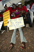 Linda Aduda (with placard) Aids Activist AIC youth mass rally at the Kenyatta International Conference Centre to send a message to the G8 Summit. Organised ActionAid Nairobi.ActionAid Get on Board cam... - Jess Hurd - 01-05-2005