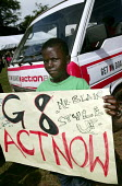 Collecting messages at the University Campus in Nambale Kampala. Uganda. ActionAid Get on Board campaign. The Joburg to G8 bus is collecting messages to take to the world leaders at the G8 Summit in G... - Jess Hurd - 08-05-2005