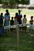 Boys and girls delay Sex - sign at the Kapelebyong Primary School, Camp Kapelebyong - displaced peoples camp Katekwi. Uganda. ActionAid Get on Board campaign. The Joburg to G8 bus is collecting messag... - Jess Hurd - 11-05-2005