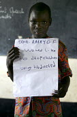Amayof with a message for the G8 leaders about abduction of children by the Lords Resistance Army. Kapelebyong Primary School at Camp Kapelebyong - displaced peoples camp Katekwi. Uganda. ActionAid Ge... - Jess Hurd - 11-05-2005