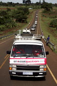 The bus convoy in the foothills of Mount Elgon. ActionAid Get on Board campaign. The Joburg to G8 bus is collecting messages to take to the world leaders at the G8 Summit in Gleneagles. Uganda. - Jess Hurd - 12-05-2005