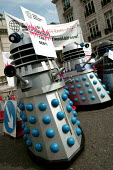 "Protesting Daleks tell G7, ''Save the humans - Exterminate the Debt"". World Development Movement demonstration outside the meeting of G7 finance ministers. Westminster, London. - Jess Hurd - 2000s,2005,activist,activists,agencies,agency,aid,Anti Capitalist,assistance,CAMPAIGN,campaigner,campaigners,CAMPAIGNING,CAMPAIGNS,capitalism,capitalist,charitable,charities,charity,Dalek,daleks,debt,"