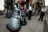 "Daleks get Stopped and Searched by the Metropolitan police on their way to tell the G7, ''Save the humans - Exterminate the Debt"". World Development Movement demonstration outside the meeting of G7. W... - Jess Hurd - 11-06-2005"