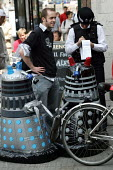"Daleks get Stopped and Searched by the Metropolitan police on their way to tell the G7, ''Save the humans - Exterminate the Debt"". World Development Movement demonstration outside the meeting of G7. W... - Jess Hurd - 2000s,2005,activist,activists,adult,adults,agencies,agency,aid,and,assistance,beat,CAMPAIGN,campaigner,campaigners,CAMPAIGNING,CAMPAIGNS,charitable,charities,charity,CLJ,clj crime law and justice,Dale"