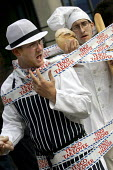 A local butcherand baker in a theatrical protest against supermarket Tesco and their monopoly of the industry. Organised by Friends of the Earth and ActionAid outside Tescos AGM, Queen Elizabeth Confe... - Jess Hurd - 24-06-2005