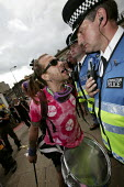 Riot police confront protesters on The Carnival For Full Enjoyment. Demonstration in Edinburgh Scotland G8 Summit of world leaders in Gleneagles, Scotland. - Jess Hurd - 2000s,2005,activist,activists,adult,adults,against,anti,anti capitalism,Anti Capitalist,argue,arguing,argument,CAMPAIGN,campaigner,campaigners,CAMPAIGNING,CAMPAIGNS,CLJ law,communicating,communication