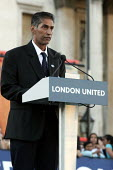 Patrick D'Cruz TGWU bus driver based at Shepards Bush speaks at London United - Trafalgar Square vigil for the victims of the London Bombings. Organised by the Mayor of London, the TUC and faith and community leaders. London. - Jess Hurd - 2000s,2005,7/7,activist,activists,anti war,Antiwar,asian,black,BME Black minority ethnic,bomb,bombing,bombings,bombs,bus,bus service,BUSES,CAMPAIGN,campaigner,campaigners,CAMPAIGNING,CAMPAIGNS,DEMONSTRATING,demonstration,DEMONSTRATIONS,driver,DRIVERS,DRIVING,London,Mayor,MAYORAL,MAYORS,member,member members,members,pacifism,peace,people,protest,PROTESTER,PROTESTERS,protesting,protests,service,services,terrorism,terrorist,TGWU,Trade Union,Trade Union,trade unions,Trades Union,Trades Union,trades unions,UK,victim,victims,vigil,worker,workers