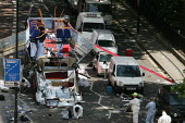 London terrorism bus bombing 2005. Police forensic officers sift the ground for evidence surrounding the bus blown up in Tavistock Square - Jess Hurd - 10-07-2005