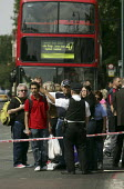 Police cordon off a street after an explosion on a bus on Hackney Road in the east end of London. The bus was blown up as part of what appeared to be a coordinated series of bombings and bomb warnings... - Jess Hurd - 21-07-2005