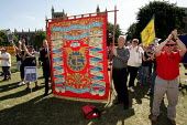 TGWU Region 2 banner at a rally for the reinstatement of Jerry Hicks Amicus convenor at Rolls Royce Bristol. - Jess Hurd - 2000s,2005,activist,activists,Amicus,CAMPAIGN,campaigner,campaigners,CAMPAIGNING,CAMPAIGNS,DEMONSTRATING,demonstration,DEMONSTRATIONS,dispute,disputes,INDUSTRIAL DISPUTE,member,member members,members,