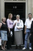 Sue Smith mother of Pte Phillip Hewett of 1st Battalion Staffordshire Regiment, who was killed on 16 July 2005, in Maysan province, Iraq, hands a letter into 10 Downing Street. Stop the War Peace and... - Jess Hurd - 2000s,2005,activist,activists,adult,adults,anti war,Antiwar,CAMPAIGN,Campaign for nuclear disarmament,campaigner,campaigners,CAMPAIGNING,CAMPAIGNS,CND,DEMONSTRATING,demonstration,DEMONSTRATIONS,famili