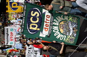 PCS banner joins Stop the War Peace and Liberty march. London. - Jess Hurd - 2000s,2005,activist,activists,anti war,Antiwar,CAMPAIGN,Campaign for nuclear disarmament,campaigner,campaigners,CAMPAIGNING,CAMPAIGNS,CND,DEMONSTRATING,demonstration,DEMONSTRATIONS,MAB,member,member m