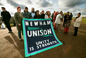 Union members from Newham Unison stand in solidarity with the sacked Gate Gourmet workers. The workers demand their reinstatement after they were sacked from their catering jobs at Heathrow Airport. U... - Jess Hurd - 23-10-2005